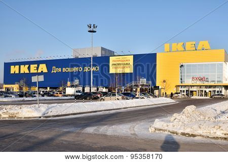 NOVOSIBIRSK, RUSSIA - JANUARY 13, 2015: People and cars near the hypermarket IKEA during Christmas sales. There is a grand total of 301 IKEA stores in 37 countries