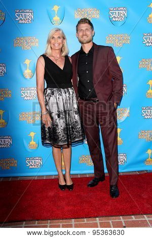 BURBANK - JUNE 25: Travis Van Winkle and guest arrive at the 41st Annual Saturn Awards on Thursday, June 25, 2015 at the Castaway Restaurant in Burbank, CA.
