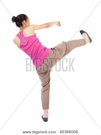 skinny woman funny fights waving his arms and legs. Rear view people collection.  backside view of person.  Isolated over white background. African-American doing lunges and kicking.