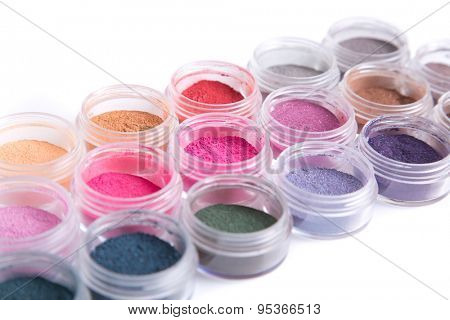 Close-up view of mineral eye shadows, isolated on white background
