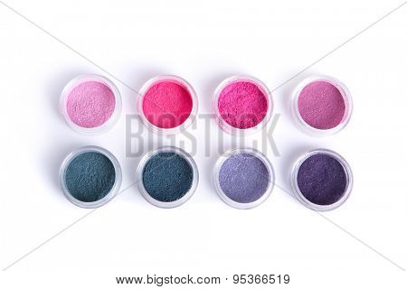 Vegan mineral eye shadows, top view isolated on white background with natural shadow