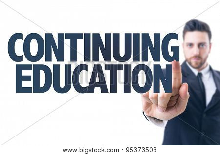 Business man pointing the text: Continuing Education