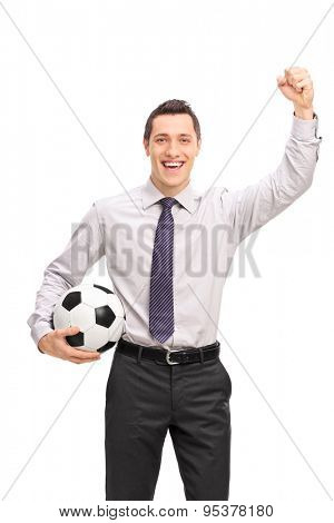 Vertical shot of a joyful businessman holding a football and cheering isolated on white background