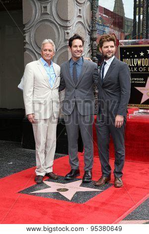 LOS ANGELES - JUL 1:  Michael Douglas, Paul Rudd, Adam Scott at the Paul Rudd Hollywood Walk of Fame Star Ceremony at the El Capitan Theater Sidewalk on July 1, 2015 in Los Angeles, CA