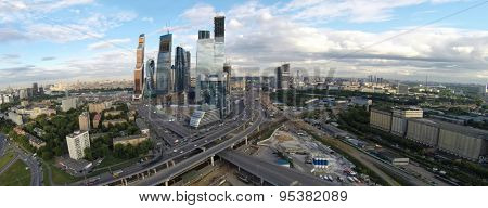 RUSSIA, MOSCOW - JUN 19, 2014: Aerial view skyscrapers complex of Moscow Business Center near interchange with traffic at summer day. Photo with noise from action camera