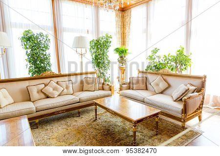 Novi Petrivtsi, Ukraine - May 27, 2015 Mezhigirya residence of ex-president of Ukraine Yanukovich. Luxurious living room with modern furniture and plants