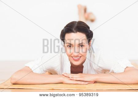 a woman in a meditation position against a white background