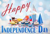 happy independence day, national holidays, celebration, food and patriotism concept - close up of hot dog with american flag decoration, potato chips and drinks on 4th july at home party poster