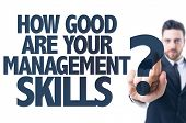 Business man pointing the text: How Good Are Your Management Skills? poster