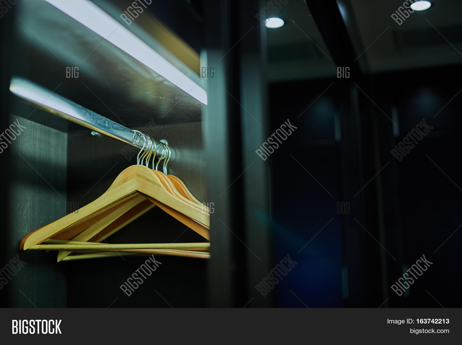 Dark in closet Man Cave Background Boutique Brown Cloakroom Closet Closeup Cloth Clothes Clothing Concept Dark Domestic Dress Empty Equipment Fashion Hanger Holder Hook Luxury Better Homes And Gardens Background Boutique Image Photo free Trial Bigstock