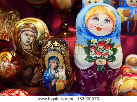 Matrioska representing a young girl with flowers. On sale in a christmas street market.