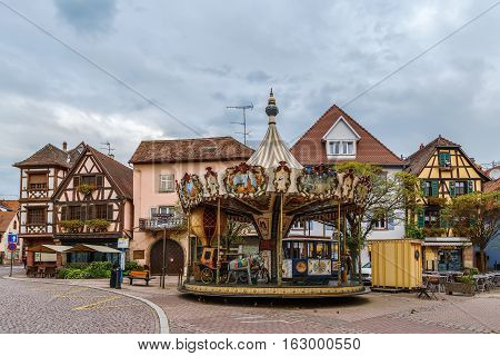 Carousel on square in Obernai city center Alsace France