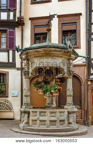 Old six-bucket well in Obernai city center Alsace France