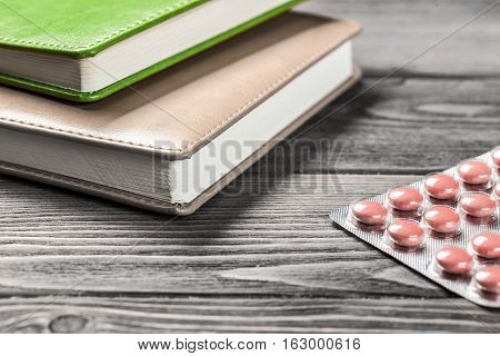 Pills on grunge wooden table. Medicine and drugstore concept