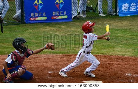 ZHONGSHAN GUANGDONGChina - October 27:unknown batter hit the ball in a baseball game on October 27 2016.