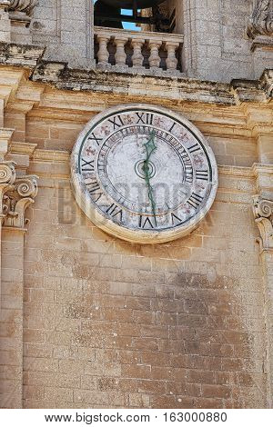 Old clock with Roman numerals on a bell tower