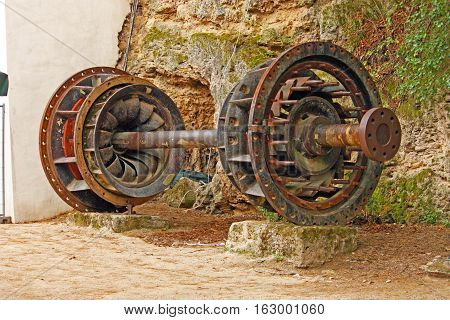 Old turbine from Jaruga power plant second hydro power plant in the world located on Krka river Croatia
