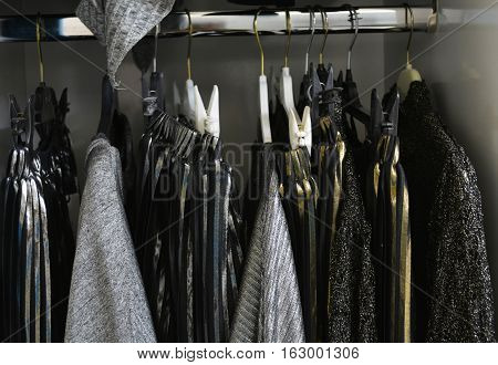 hanger in the dressing room with things in black-and-gray color scheme