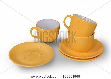 orange cup and saucer isolated on a white background