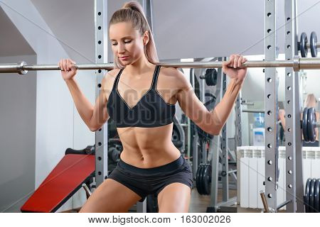 Portrait of sporty female doing physical exercise in gym