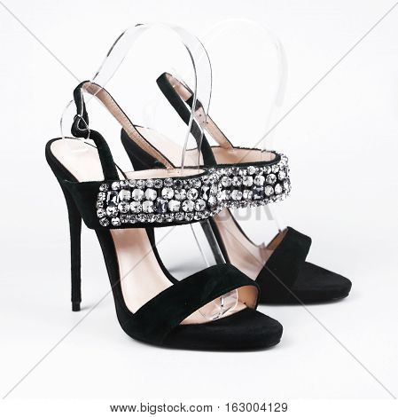 summer black female shoes in white background