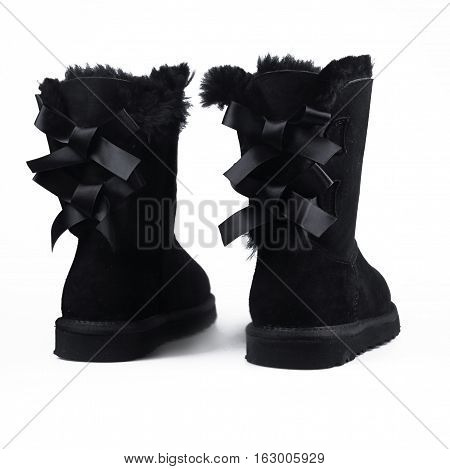female black winter shoes over white background