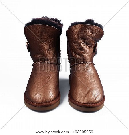 Australian brown Trendy winter shoes. Fur women's boots on white background