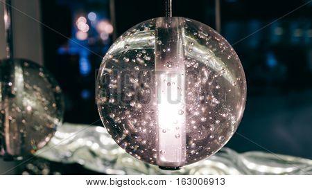 Modern Designer Chandelier. Modern Design And Lighting Design Of The Room. Design Of Light And Space