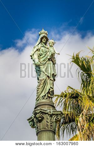Column of Holy Virgin Mary Stella Maris Madonna statue opposite to Stella Maris Monastery in Haifa Israel. Close-up