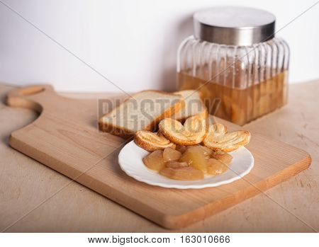 reakfast: toast with apricot jam, bread, biscuits