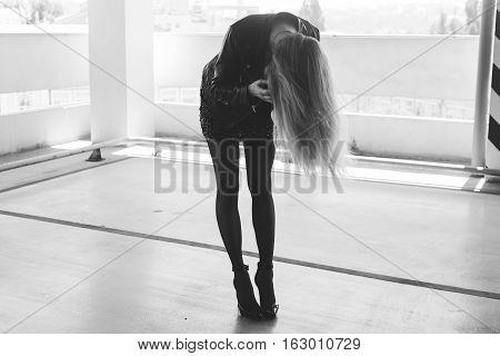 Girl With Long Legs In The Way Rock Stars. Rocker Girl Smokes A Cigarette, Pretty Girl Rocker. Film