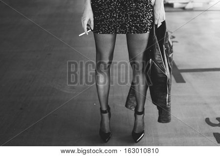 Girl With Long Legs In The Way Rock Stars. Rocker Girl Smokes A Cigarette, Pretty Girl Rocker. Film