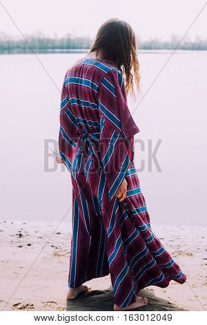 Beautiful Hippie Girl Walking Near The Shore Girl In A Dress, Conscious Lifestyle. Film Texture & Un