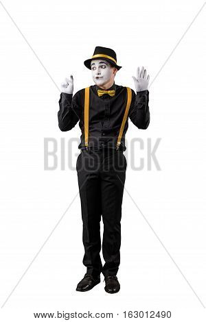 Male mime in black shirt and hat isolated on white background