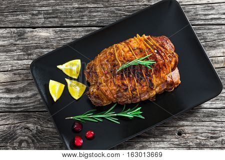Delicious Turkey Meat Roulade Grilled  On Black Rectangular Dish