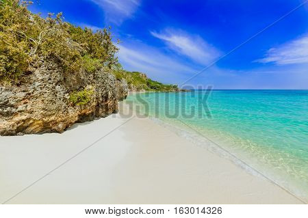 stunning beautiful gorgeous view of tropical white sand beach and ocean against blue sky background on sunny summer day