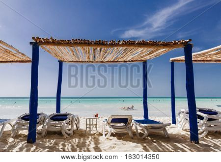 great amazing beautiful view of Cuban Cayo Coco island beach with people relaxing in background on sunny gorgeous day