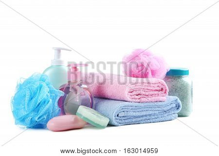 Towels With Soap, Wisp And Bottles Isolated On A White Background