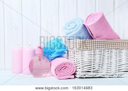 Towels With Wisp And Candle On White Wall Paneling Background