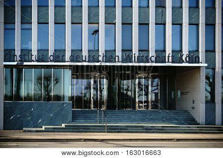 COLOGNE, GERMANY - NOVEMBER 24: The facade and the entrance of the institute of the German economy with logo and glass revolving doors on November 24, 2016 in Cologne.