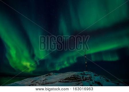 Radio Tower On The Hill And The Northern Lights Over The Fjord In The Background, Nuuk Greenland