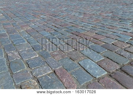 Old road paved with the cobble stones street of Tallinn stock photo