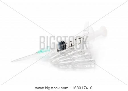 Medical syringe and vial isolated on a white background