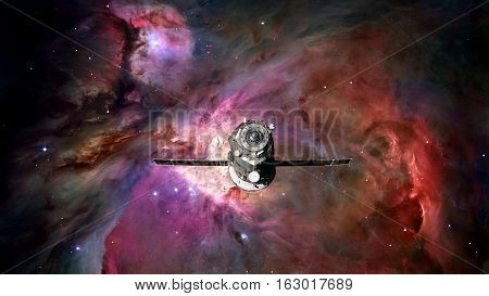 Spacecraft Progress orbiting the space nebula. Elements of this image furnished by NASA.
