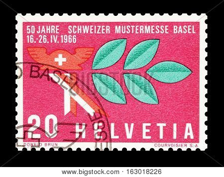 SWITZERLAND - CIRCA 1966 : Cancelled postage stamp printed by Switzerland, that shows Mercury hat and laurel branch.