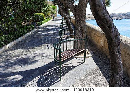 Wrought iron benches on the Malta waterfront