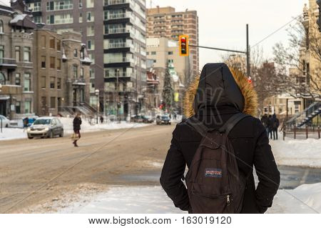 Montreal CA - 17 December 2016: Snowstorm in Montreal. Pedestrian on Sherbrooke street.