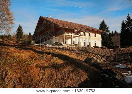 Cottage from the winter Mountains Sumava in southern Czech