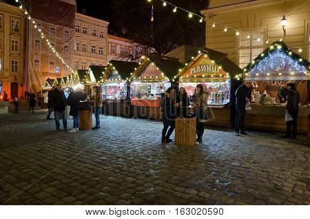 LVIV UKRAINE - DECEMBER 22: Christmas and New Year bazaar in the center of Lviv on Market Square on December 22 2016 in Lvov Ukraine