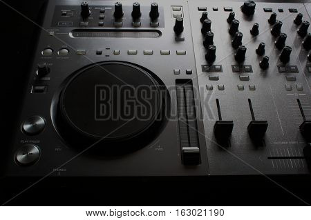 dj turntable on the black background abstract